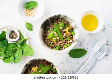 Healthy food. green buckwheat. High protein vegetable food: buckwheat, young green peas, capsicum yellow, spinach, pine nuts bowl of health. The concept of eating. Mediterranean cuisine. Trend