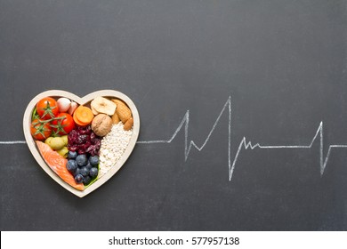 Healthy food in heart and cardiograph on blackboard medical abstract concept - Shutterstock ID 577957138