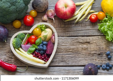 Healthy food in heart diet cooking concept with fresh fruits and vegetables