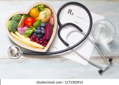 Healthy food in heart stethoscope and medical prescription diet and medicine concept