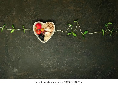 Healthy food in heart and vegetable cardiograph on old kitchen table blackboard medical abstract concept. Top view.