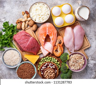 Healthy food high in protein. Meat, fish, dairy products, nuts and beans. Top view