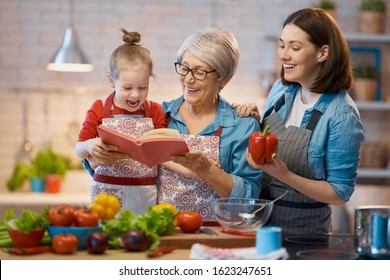 Healthy food at home. Happy family in the kitchen. Grandma, mother and child daughter are preparing the vegetables.