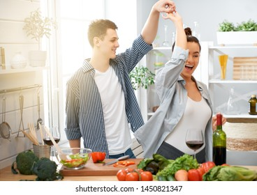 Healthy food at home. Happy loving couple is preparing the proper meal in the kitchen.