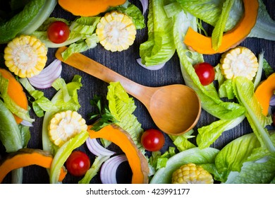 Healthy food ingredients background. Lettuce, tomatoes, parsley Organic vegetables on gray background