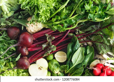 Healthy food ingredients background. Set vegetables, fruit, and herbs top view. Celery, parsley, onion, Brussels sprouts, lettuce leaves, lime, baby spinach, broccoli, green apple and young beets