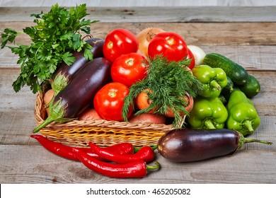 Healthy food ingredients. Fresh vegetables, herbs. Organic vegetables on wooden table. Healthy nutrition.