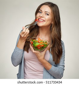 healthy food, healthy life style with young woman eating salad. isolated portrait on white background.
