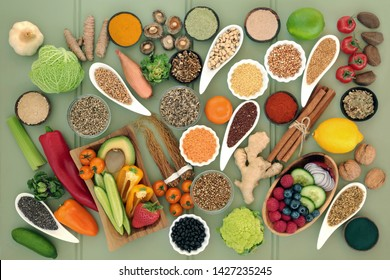 Healthy food for liver detox concept with fruit, vegetables, legumes, grains, seeds, herbs & spices used in herbal medicine & supplement powders. High in antioxidants, vitamins and dietary fibre.