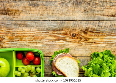 healthy food in lunchbox for dinner at school wooden table backg