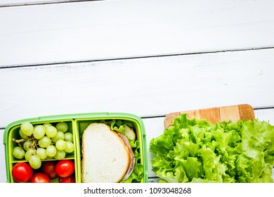 healthy food in lunchbox for dinner at school white table backgr