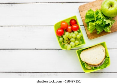 healthy food in lunchbox for dinner at school white table background top view mockup