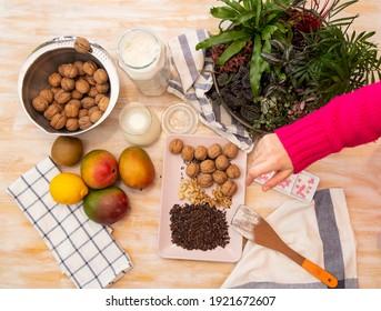 Healthy Food, Mango, Walnuts, Choclate, Chocolate Nips, on wooden background