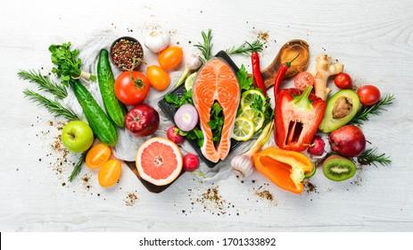 Healthy food menu: fish meat, vegetables and fruits. Diet menu.