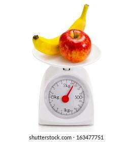 Healthy food on balance scale.