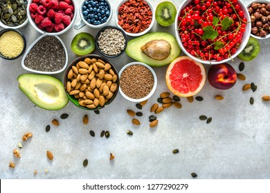 Healthy food on table. Breakfast in a bowls with fresh products, organic superfood, vegan diet with fruits, nuts and berries,