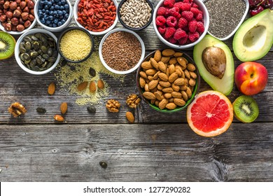 Healthy food on table. Vegan and vegetarian diet concept, super foods, flat lay, top view.