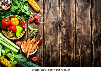 Healthy food. Organic vegetables. Fresh vegetables with herbs. On wooden background.