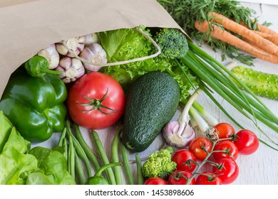 Healthy food in paper bag of different  vegetables on white background. Top view