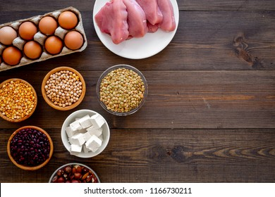 Healthy food. Products rich protein and fiber. Legumes, nuts, low-fat cheese, meet, eggs. Raw beans, chickpeas, lentil, almond, hazelnut on dark wooden background top view copy space