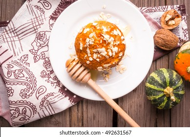 Healthy food - pumpkin muffins with oatmeal. In the rustic table, top view, surrounded by decorative pumpkins and nuts