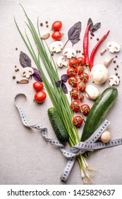 Healthy food, raw vegetables in bouquet shape and measuring tape. Diet, lifestyle, clean eating, vegetarian concept