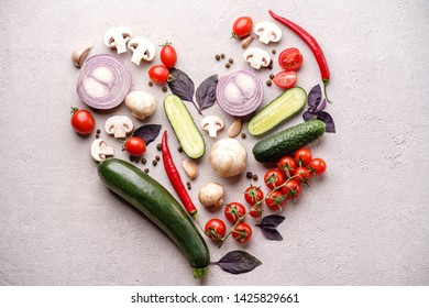 Healthy food, raw vegetables in heart shape. Diet, lifestyle, clean eating, vegetarian concept