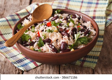 Healthy food: rice with red beans in a bowl close-up on the table. horizontal