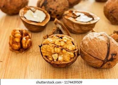 Healthy food safety concept:Walnuts kernels on dark desk with color background