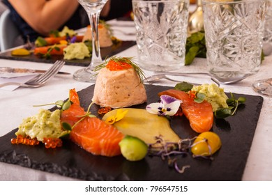 Healthy food with salmon on black background