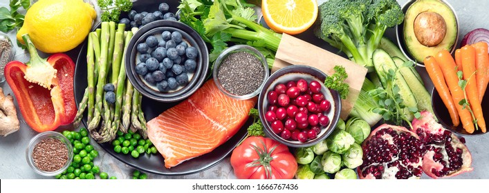 Healthy food selection on gray background. Detox and clean diet concept. Foods high in vitamins, minerals and antioxidants. Anti age foods. Top viewю Panorama, banner