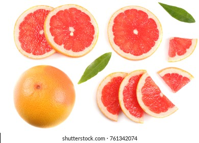 healthy food. sliced grapefruit with green leaf isolated on white background top view