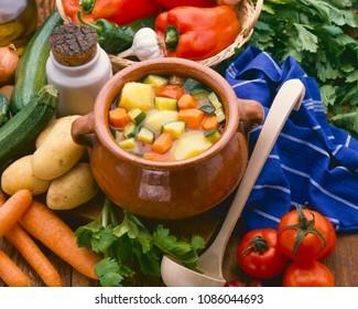 Healthy food. Stewed vegetables in a ceramic pot.