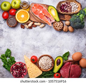 Healthy food and superfood background. Meat, fish, legumes, nuts, seeds, greens, oil and vegetables Top view copy space