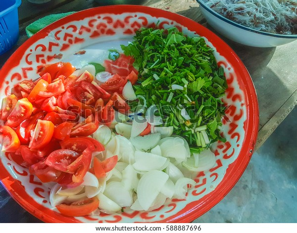 healthy food with tomato onion and chives