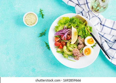 Healthy food. Tuna fish salad with eggs, lettuce, cherry tomatoes, avocado and red onions.  French cuisine. Top view, copy space, flat lay