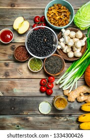 Healthy food. Variety of organic vegetables and mushrooms . On a wooden background.
