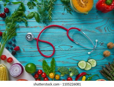 Healthy food vegetables for heart heath on wooden turquoise background
