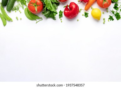Healthy food vegetarian food background. Set of fresh vegetables and fruits on white background top view