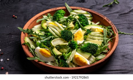 Healthy food. healthy vegetarian lunch bowl. Fresh green salad on dark woden background, banner, menu recipe place for text, top view.