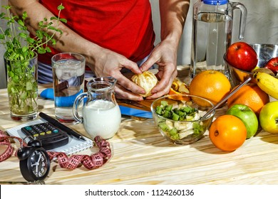 Healthy food, Young girl preparing fruit salad. Fresh fruits on the wooden table, Proper nutrition. closeup.