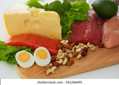 Healthy Foods. Closeup Of Variety Of Food Ingredients, Fresh Organic Vegetables, Raw Meats In Kitchen. Different Food Products Lying On Table. Nutrition Concept. High Resolution