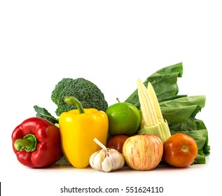 Healthy foods - fresh vegetables and fruits on white background with space