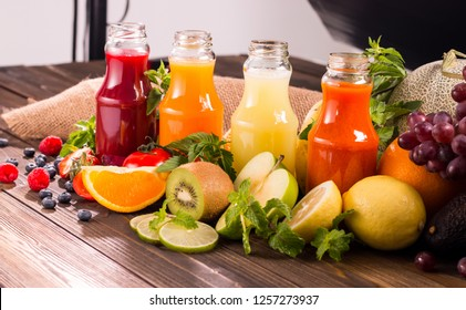 Healthy foods with juices placed and group of fruits on the table