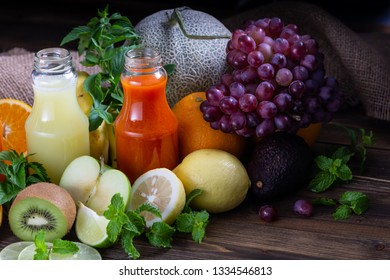 Healthy foods with juices placed and group of fruits on the table.