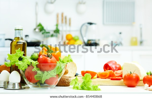 healthy foods are on the table in the kitchen