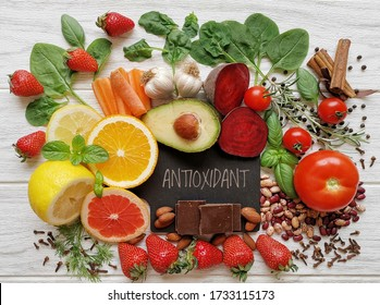 Healthy foods rich in antioxidants. Fresh fruit and vegetable, set of various spices and herbs high in antioxidants. Natural sources of antioxidants. Concept of diet and healthy eating.