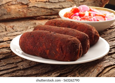 Healthy food-Tasty and spicy chicken meat rolls with fresh salads,