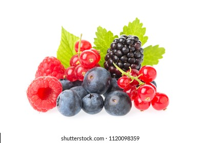 Healthy fresh food berries group. Macro shot of fresh raspberries, blueberries, blackberries, red currant and blackberry with leaves isolated on white background.