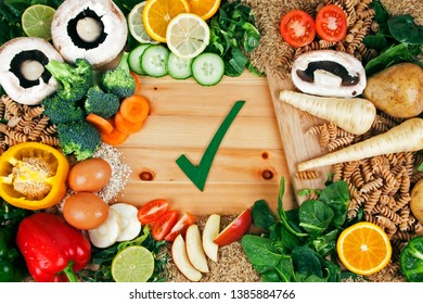 Healthy fresh food, vitamins, vegetables, salad, dairy, greens and fruit - health concept for good nutrition, a balanced diet, fitness and vitality.